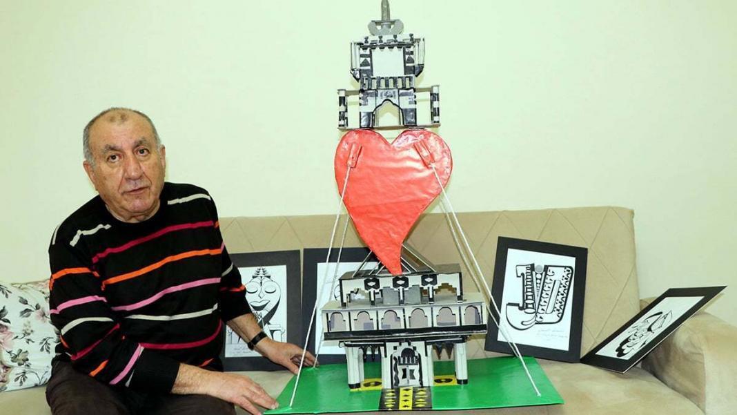 Fon kartonlardan maket kuleler yapıyor